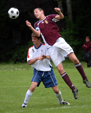 Soccer player heading a soccer ball